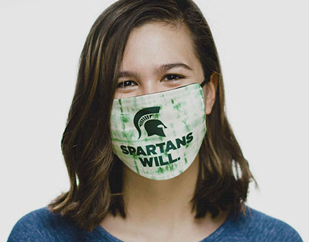 Woman with mask that says Spartans Will