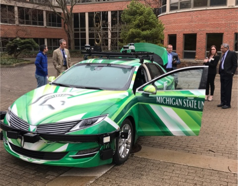 Researchers with an autonomous vehicle