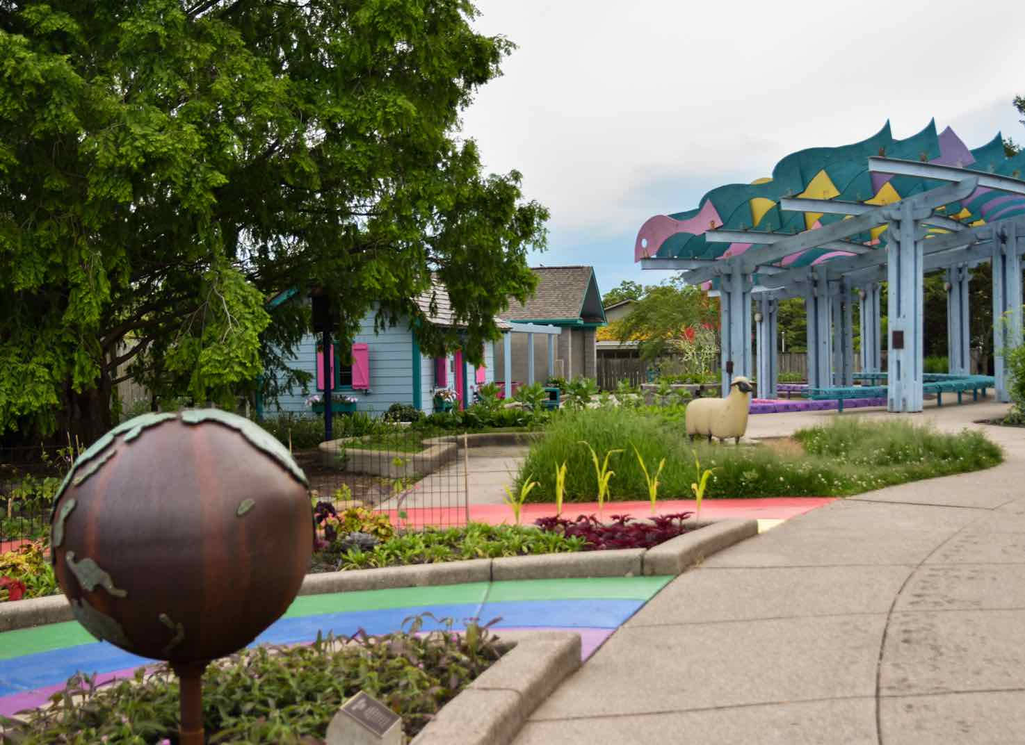 Colorful flowers and building in the 4-H Children's Garden